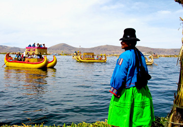 Uros woman watching the boats on Lake Titicaca near Puno.
