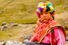 Girl in traditional Andean clothing during the Lares trek to