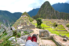 Resting while overlooking the Inca ruins of Machu Picchu Arc