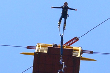 Girl leaping from bungee lift near Cusco Peru