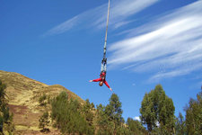 Bungee jump freefall in the Andes near Cusco Peru