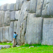 Cover Photo. Man at the Inca fortress of Sacsayhuaman in Cus