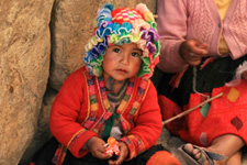Traditionally dressed girl in the street in Cusco, Peru.