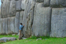 Tourist at the Inca Fortress of Sacsayhuaman in Cusco, Peru.