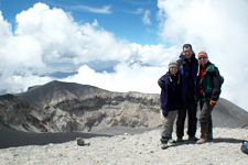 Three hikers in front of the rim of El Misti Volcano's crate
