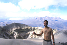 Hiker in front of the crater at the top of El Misti in Arequ