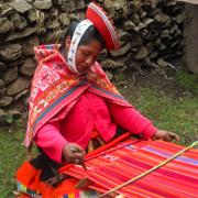 Cover Photo. Traditionally dressed weaver in Cusco Peru.