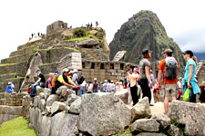 Visiting the Inca ruins of Machu Picchu Citadel in Peru.