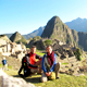 Couple visiting the Inca ruins of Machu Picchu in Peru.