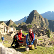 Cover Photo. Couple visiting the Inca ruins of Machu Picchu