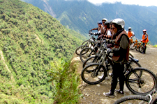 Bikers looking into the abyss from Death Road near La Paz, B