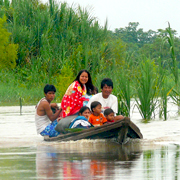 Cover Photo. Locals navigating the Amazon River near Iquitos