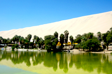 Huacachina Lagoon in the desert by Ica, Peru.