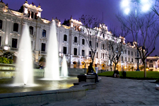 Fountains in San Martin Plaza in Lima, Peru, at night.