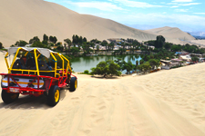 Sandbuggy heading to Huacachina Oasis in desert near Nazca P