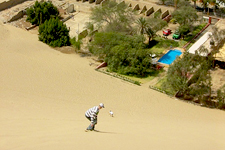 Sandboarding by Huacachina Oasis in Ica region near Nazca, P
