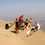 Cover Photo. Sandboarding by Huacachina Oasis near Nazca, Pe